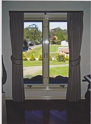 Pinch Pleated Curtains with tiebacks piped in black to match with pole.