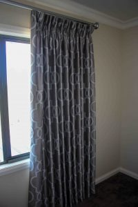 Goblet pleated lined curtains. On matt silver decorative pole