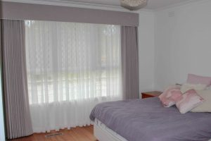Pinch pleated lined curtains with padded pelmets, over sheer curtains for privacy