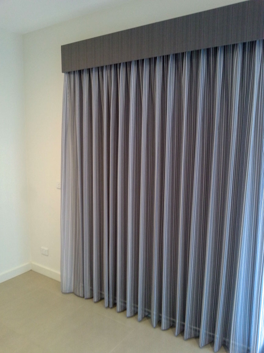 Sheer Pinch Pleated Curtains with Pelmets, and Roller Blind behind